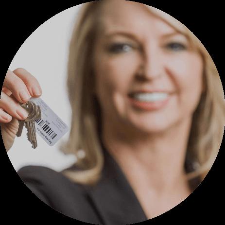 Woman holding keylog key tag